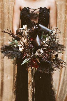 feather bouquet, photo by Hazelwood Photo http://ruffledblog.com/black-and-gold-new-years-eve-wedding #weddingbouquet #flowers #gold