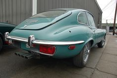 Old Jaguar E-type sports car: back fender & exhaust pipe array by Chris Devers, via Flickr