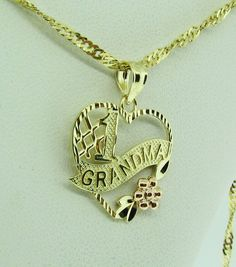 14 K gold heart shape pendant. by VintageJewelryBazaar on Etsy