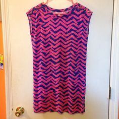 Lilly Pulitzer dress Blue and hot pink chevron pattern. Only worn a few times. Colors are still bright and vibrant! Has gold button details on shoulders. I think the print is from early 2015. No signs of wear. NO TRADES. Considering reasonable offers! :) Lilly Pulitzer Dresses Mini