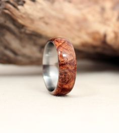 Honduras Rosewood Burl Lined with Titanium Wood Ring Titanium Ring. $175.00, via Etsy.
