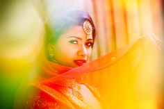 Beautiful Hindu Bride - A Hindu bride portrait taken during a real wedding with emphasis on the beautiful colours and traditional jewelry.