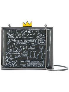 clutch Basquiat con motivos que brillan en la oscuridad
