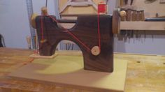 Toy sewing machine.  Walnut, oak, maple.  Ye Olde Woodworker on facebook.
