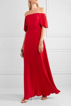 VALENTINO Off-the-shoulder silk-georgette gown $5,790 Perfect for glamorous parties and special occasions, Valentino's gown is made from silk-georgette in the label's signature shade of red. This floor-sweeping style is cut in a flattering off-the-shoulder silhouette and has delicate picot edging along the cape overlay.   Shown here with: Bottega Veneta Clutch, Alaïa Sandals, Jennifer Fisher Ring.