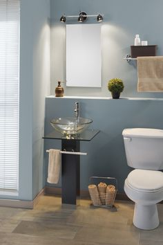 Gabinete para baño Maki que incluye lavabo de vidrio, toallero y mezcladora.