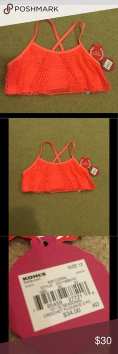 Flowy swim top This swim top is from the store Kohl's. It comes in the size girls 10-12. It's a beautiful coral orange color. With a flowy mesh material from side and in the back just regular swim suit material but crisscross straps. Will look so good with a nice tan, definitely will make your tan pop with how bright the color is. This swim top is 100% brand new with its tags still attached and never has been worn. Candie's Swim Bikinis