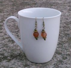 Toremore Crafts - dark amber frosted bead earrings with bronze daisy beads