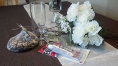 2-Supplies:  DIY Centerpiece.  Supplies: rock fillers, glue, flowers, branch, vase, baby breath