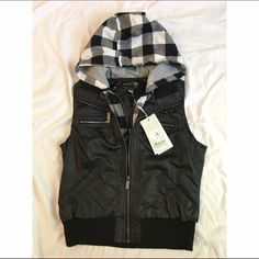 FLASH SALELeather and Plaid Hooded Vest Leather vest with plaid hoodie lining. Has slip in pockets in the front and wide banding at the bottom. Looks great with a long sleeve top and some distressed jeans or shorts! Brand new with tags! Size: L (fits more like a Medium) Jackets & Coats Vests