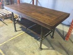 Jeffs  island table. Hard wood top steel pipe legs.