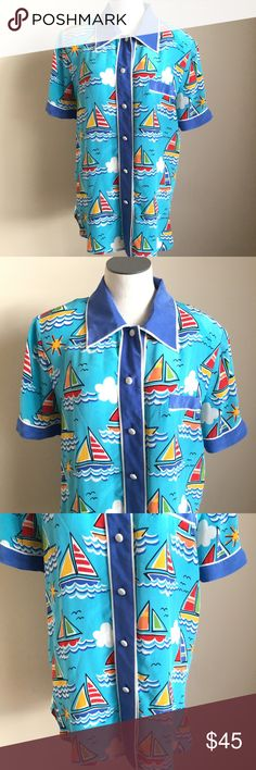 """Bob Mackie Silk Sailboat Wearable Art Blouse Small Bob Mackie women's sailboat print silk button up blouse with short sleeves  Size Small  Collar  Good condition, needs to be dry cleaned, spots on the collar and minor spot on the chest. Priced accordingly. Please view photos.   Light shoulder pads  Measurements taken while laying flat: 17"""" Shoulder to shoulder 21"""" Chest 9.5"""" Sleeve 9"""" Length 20"""" Waist Bob Mackie Tops Button Down Shirts"""