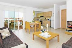 Apartment Meridian Protaras Set in Pernera, this air-conditioned apartment features a communal pool. Apartment Meridian boasts garden views from its balcony and is 700 metres from Kalamies Beach. The owners can help with airport transfers.