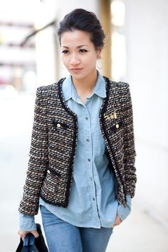 Chanel-style tweed jacket layered over a chambray shirt