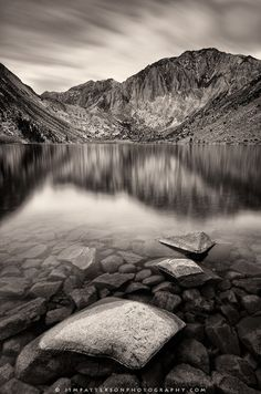 Morning clouds pass over Convict Lake and Mt. Morrison in the eastern Sierra mountain range near Mammoth Lakes. The rugged landscape is filled with small lakes and towered mountain peaks.