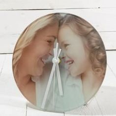 Amazing Personalised Photo Clock by PersonaliseWise - Personalised Photo Gifts. You can create your own 30cm glass clock here: www.personalisewise.com/products/personalised-clock