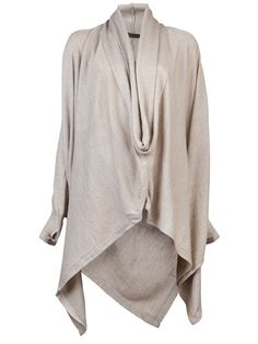 Serius thumb hole sweater in khaki from Nicholas K. This wool blend drape sweater features a cowl neck and long dolman sleeves with a suede elbow patch.  Has a front v-shaped slit and an asymmetrical hem.