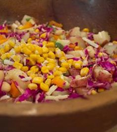 French Cafe Summer Salad: red potato, garlic, olive oil, dijon mustard, red cabbage, corn, red onion, red bell pepper, green bell pepper, yellow bell pepper, cucumber, white kidney or cannelini beans