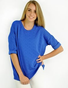 https://www.cityblis.com/5715/item/15465 | Motive top (blue) - $31 by lovemartini | Featuring a round neckline with three quarter sleeves styling. Oversized fit. Motive embossed. Loose fit. Looks great with skinnies!   Chest - 44 inches Length - 25 inches Polyester Machine wash cold Imported  Model wears a size small (US4 / UK8); is 170 cm in height Bust: 30 inches / Waist... | #Tops/Blouses