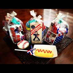 """Take Me Out To The Ball Game"" treats I made for Ryan's baseball team :). Each bag has peanuts & Cracker Jacks, sunflower seeds, licorice, Big League Chew, a baseball card, and a Baby Ruth in them. Coupled with a baseball cupcake and Twinkie dog, this is one sweet treat!!!"