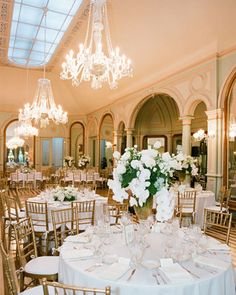 Luxe Centerpiece: Arrangements of roses, hydrangeas, French tulips, phalaenopsis orchids, and Phlox trachelium in varying heights add even more visual interest to this glamorous ballroom.