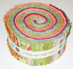 jelly roll of quilt fabric samples form a spiral