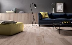 Wood-like finished ceramic tile flooring (for the man cave). ABK group Industrie Ceramiche S.p.A.