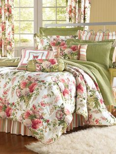 Claire's Garden Comforter - This classic cottage bedroom is reinvented with a trio of flirty fabrics: floral bouquet, panel stripe, and a windowpane plaid. The comforter, stand