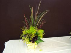 July 2014 meeting of The Mid Island Floral Art Club in Qualicum Beach B.C. Canada, Forest Finds. See us at mifag.org or on Facebook