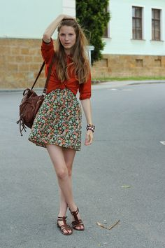 That bold red-orange button-up looks awesome over the dress, and those strappy brown sandals are really pretty, too.