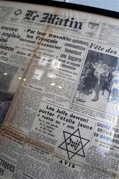"In this photo taken Monday, July 16, 2012 shows the front page of daily newspaper Le Matin reading ""Jews must wear the yellow star starting July 7"" coming from the Archives of Paris Police Prefecture is presented for an exhibition of French archives on Shoah in Paris. It coincides with the 70th anniversary of the Vel' d'Hiv roundup by Paris police of some 13,000 Jews over two days who were then sent to Auschwitz death camp."