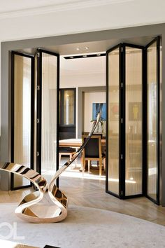 Sheer fabric inlay on folding doors for texture and to diffuse.