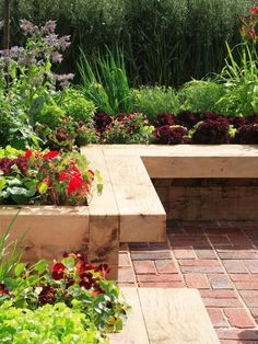 Raised bed Bench: Raised beds with wide tops allow you to tend your crops without bending or kneeling. Use thick lumber for the bed, and attach the wider seating edge along the top with long coach bolts.