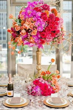 Colorful flowers and chevron linen #wedding #centerpieces ~ Photography: ThisBe Grace Photography // Flowers:  Jordan Payne Events | http://www.bellethemagazine.com/2013/12/25-stunning-wedding-centerpieces-part-22.html