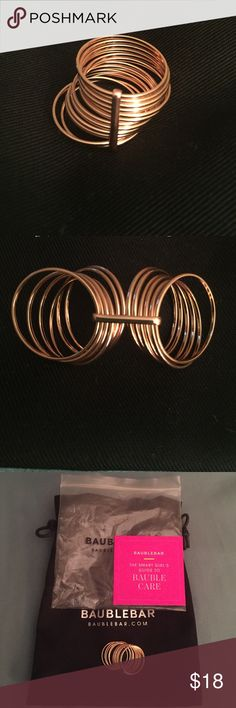 Slinky Stack Ring 14K Rose Gold plated stack ring. 12 Rose gold rings held together with bar. Very trendy and fashionable! Brand new, never worn. Comes in original packaging with draw string pouch. Bauble Bar Jewelry Rings