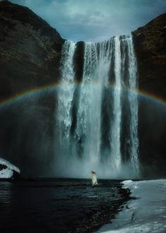 Skogafoss, by TJ Drysdale... #sky #landscape #beauty #winter #rainbow #nature #clouds #rocks #beautiful #snow #model #waterfall #ice #power #naturallight #iceland