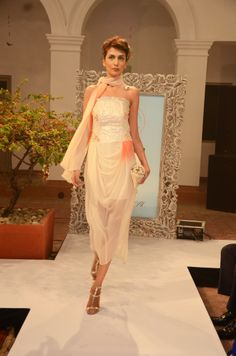 Off white and sunset orange cowl dress with silver shimmer-sea trims (INR 12,600)