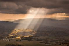 The Light - rays of light descended from the sky before a storm. Photography by Lazar Ovidiu