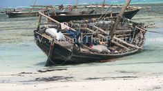 A beached boat on Ras Nungwi beach on the island of Zanzibar in Tanzania