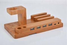 With its multiple grooves and four USB ports, the wooden charging station charges your mobile devices, and integrated Apple Watch stand keeps your smartphone in