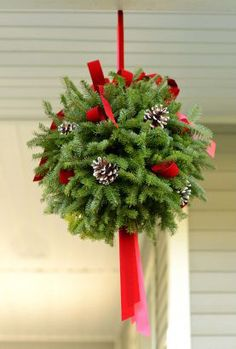 Decorate the front of your porch or garage by replacing your summer hanging baskets with a lovely, brightly decorated, fragrant kissing ball and maybe catch that special person under one at your home! Our kissing ball is a full to in diameter. Christmas Greenery, Christmas Porch, Outdoor Christmas Decorations, Christmas Balls, Diy Christmas Gifts, Christmas Projects, Winter Christmas, Christmas Holidays, Christmas Wreaths