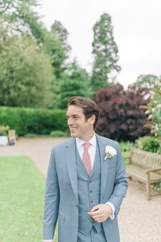 Groom in Three Piece Cad & The Dandy Light Blue / Grey Suit with Dusky Pink Polka Dot Tie | Pastel pink, Mint Green & White Colour Scheme with Gold Accents | Stately Home Country Wedding Venue | Outdoor Ceremony | Marquee Reception | Photography by Sarah-Jane Ethan | http://www.rockmywedding.co.uk/simone-tim/