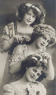 victorian beauty. I love the dresses, hair, accessories. Beautiful portrait.  It looks like sisters just having fun