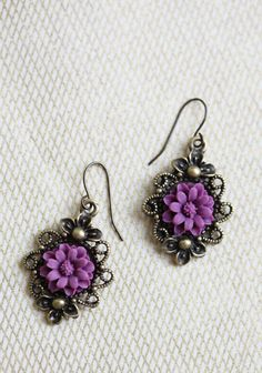 "Aureate Dream Flower Indie Earrings 26.99 at shopruche.com. These ornate brass earrings exude vintage charm with purple floral accents., ,  1.75"" long"