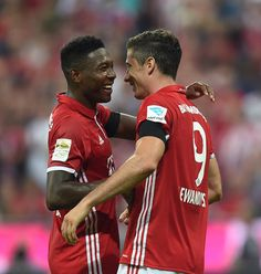 Bayern Munich's Austrian midfielder David Alaba and Bayern Munich's Polish striker Robert Lewandowski celebrate a goal during the German first...