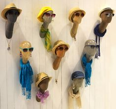 Wall-mounted accessory display heads - visual merchandising - cool idea