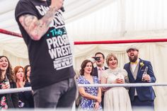 A unique and alternative Skylark Farm wedding, with a wrestling theme and live wrestling match! Creatively captured by London wedding photographer Babb Photo including dynamic documentary coverage of wrestlers in mid air! Documentary Wedding Photography, Creative Wedding Photography, Wedding Story, Farm Wedding, Guest Book Table, Wedding Planning Guide, Skylark, Wedding Entertainment, London Wedding