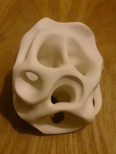 Nature inspired white ceramic,  unglazed