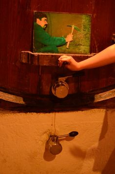 small hole in the barrel for people to enter and clean it