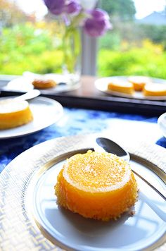 Quindim   Vancity Foodie    Quindim is a dessert thats really popular in Brazil – its a sweet coconut custard that has an amazing crunchy bottom and a creamy top. They come out of their little muffin tins with a beautiful yellow color. They also need to go into the oven in a water bath in order to cook properly! looks yummy!!!!